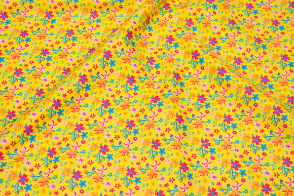 Clear yellow cotton with pink flowers