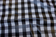 Coated fabric with black and white 3 cm checks