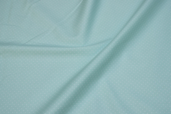 Delicate green cotton with small 1 mm white dots
