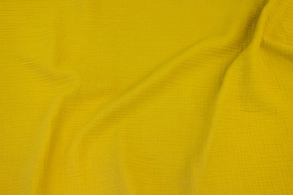 Double-woven cotton-crepe (gauze) in brass-yellow