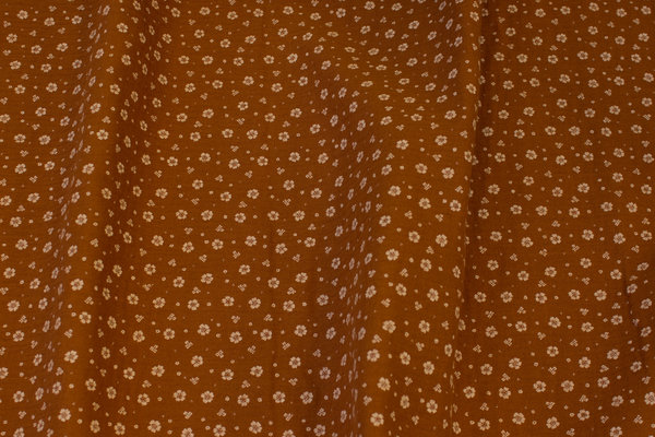 Double-woven cotton-crepe (gauze) in cinnamon-colored with small light flower