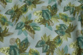Dusty-green cotton-poplin with green leaves.