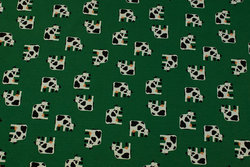 Grass green cotton-jersey with ca. 2.5 cm big cows