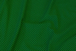 Grass green cotton-jersey with light green mini-dots