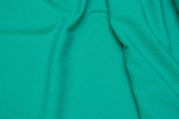 Green cotton and polyester crepe with lightweight stretch