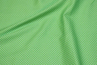 Green cotton with small white dots