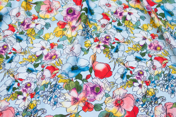 Light blue polyester-microsatin with flowers in red, yellow etc.
