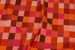 Light sweatshirt fabric with chess checks in coral colors