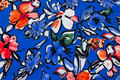 Lightweight, blue micro-polyester with big flowers in blue and coral.