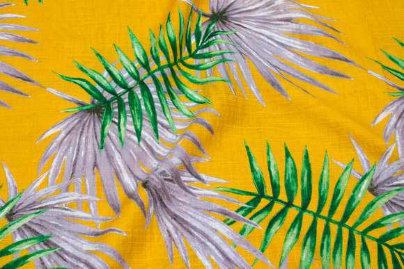 Lightweight, structure-woven cotton and viscose in yellow with green and light grey leaves