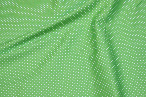 Lime green cotton with small white dots