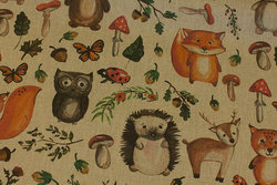 Medium-thickness, linen-colored cotton with forest-animals