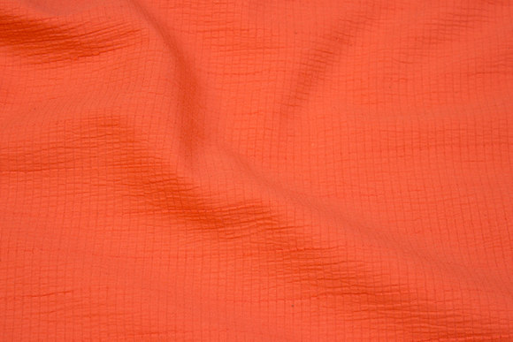 Orange cotton and polyester crepe with lightweight stretch