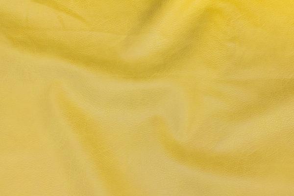 Soft, faux hide in brass-yellow