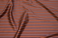 Soft, rust-colored viscose satin with narrow stripes on langs in navy and white