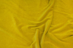 Stretch velvet in brass-yellow