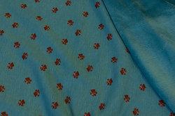 Turqoise-green sweatshirt fabric with 1 cm paw-prints