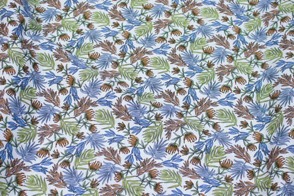 White cotton-poplin with blue, brown and green leaves