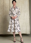 Pullover dress (fitted through the bodice) has front princess seams, shaped empire waistline, flared skirt, side invisible zipper, pointed collar and collar band, front band, and long sleeves with button cuff. Narrow hem.