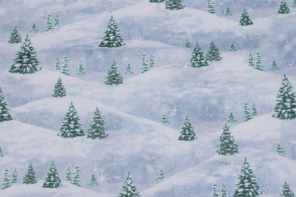 Blue-white patchwork-cotton with trees in the snow