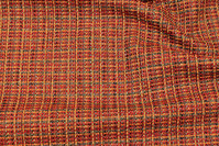 Ruggedly woven opholstry fabric in red and green nuances