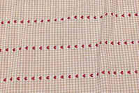Sand-colored and white table-cloth-fabric with red hearts