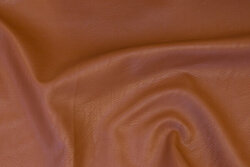Soft, light-brown imiteretskind with light surface-textured surface
