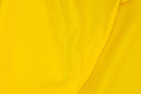 Thin, light coated crinkle pilotnylon in yellow