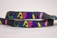 Grafitti ribbon in grey with multicolors.