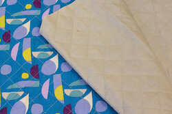 Double-sided cotton-quilt in turqoise patterned