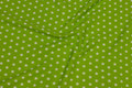 Lime-green cotton with white 1 cm stars .