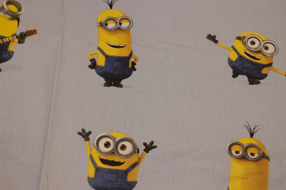 Minions on light blue or grey cotton