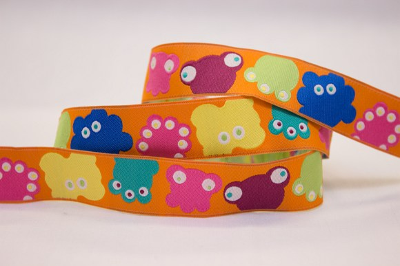 Orange bias with colored animals for sewing on