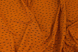 Organic, cinnamon-colored cotton-jersey with small black line
