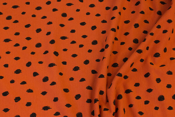 Organic, softened sweatshirt fabric in roof-color with black pattern