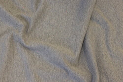 Softened sweatshirt fabric in speckled grey with very discrete colored speckles