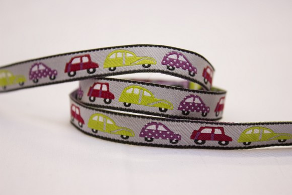 Woven drape with cars in green, red and purple on grey base