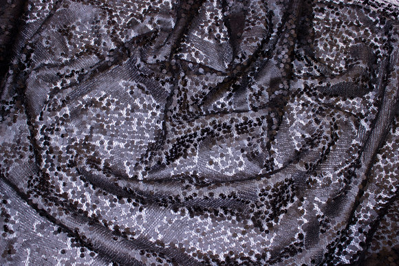 Matte-black sewn-on sequins on tulle base