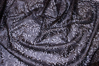Matte-black sewn-on sequins on tulle base.