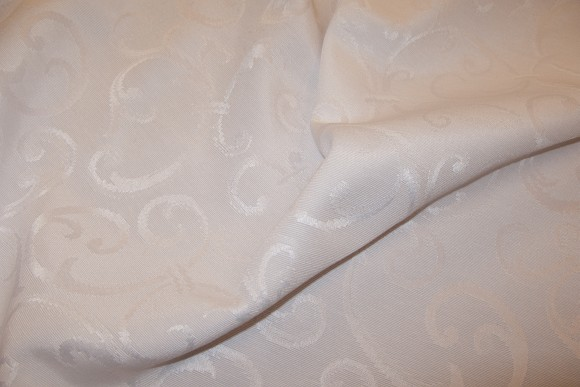 White, jacquard weave forcloth and drapes