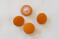 Dot buttons in orange and yellow.