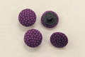 Dot buttons in purple.