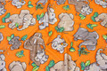 Orange patchwork-cotton with elephants .