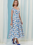 Close fitting, lined dress has pleats, gathered skirt, and side zipper.