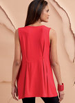 Loose-fitting tops have tucks, length and sleeve variations, and shaped hemlines.