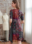 Pullover dresses, close-fitting through the bust, have pockets and sleeve length variations.