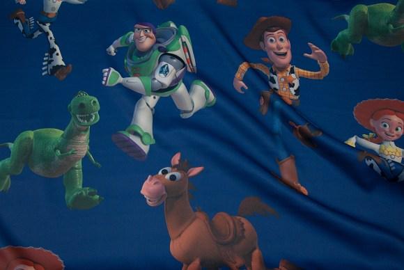Darkeblue darklægningsfabric with Buzz Lightyear, Woody, Toy Story