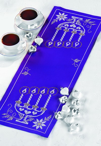 Blue table runner with candle holder