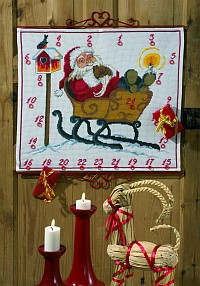 Permin 34-9252. White christmas gift calendar with Santa in the sled.