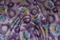 Grey and purple taffeta with circular pattern.